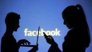Using facebook with computer or phone